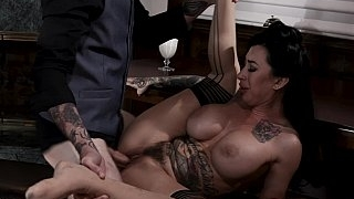 Buxomy tatted-up MILF..